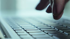 stock-footage-hands-touch-typing-on-a-laptop-keyboard